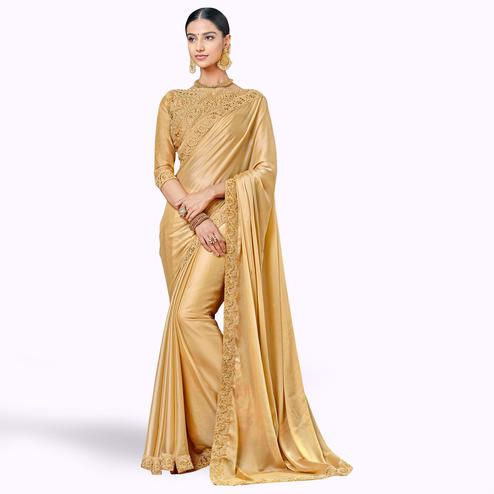 Refreshing Golden Colored Party Wear Embroidered Silk Saree