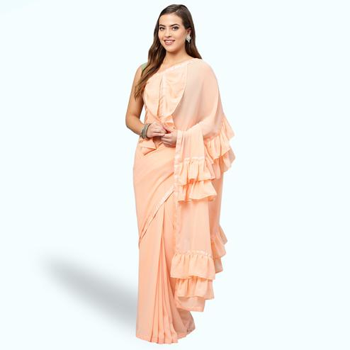 Elegant Pastel Peach Colored Party Wear Fancy Georgette Saree