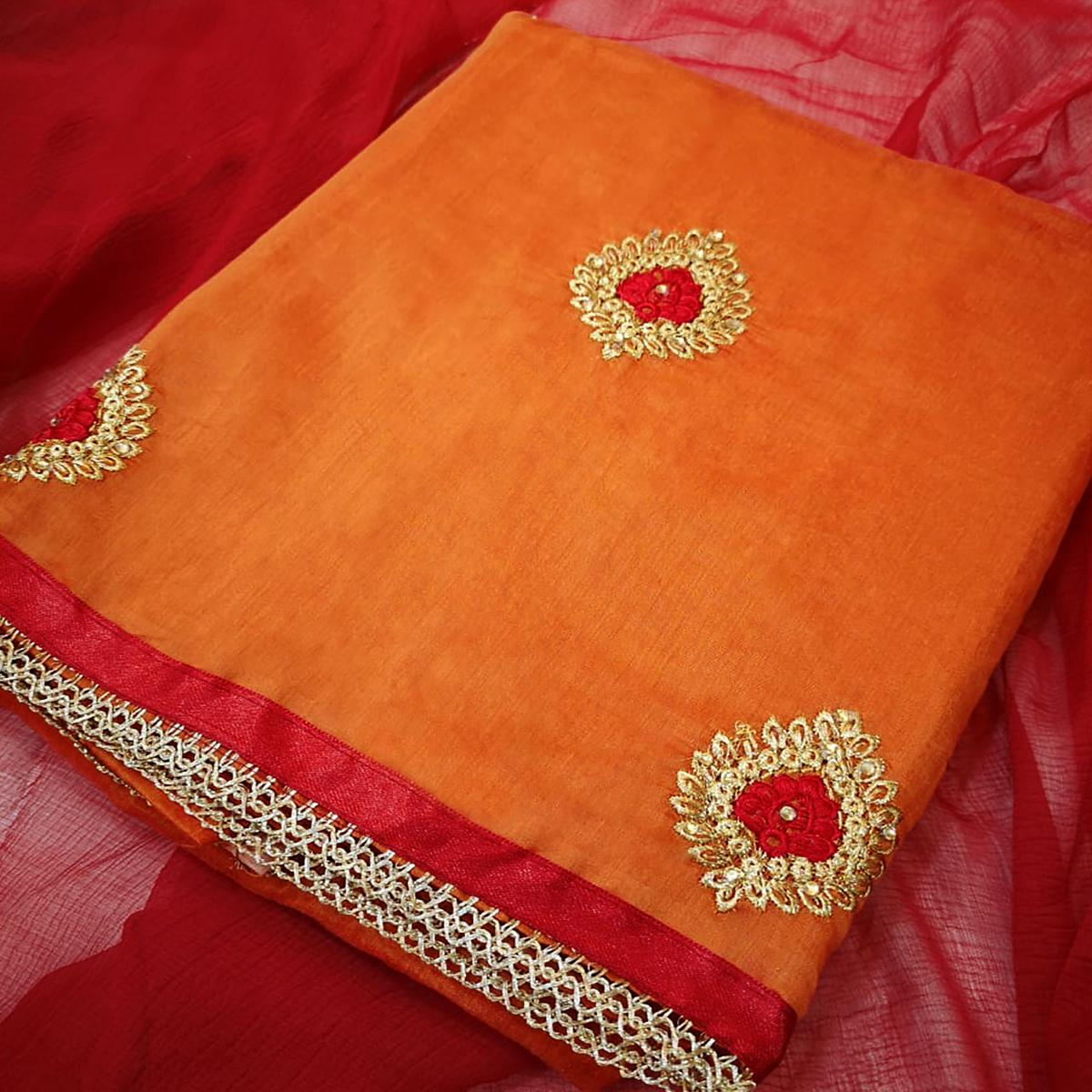 Appealing Orange Colored Partywear Embroidered Chanderi Silk Dress Material