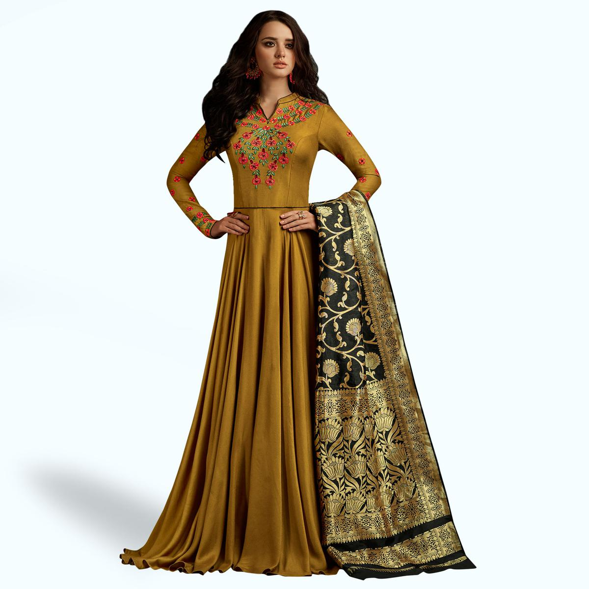 Mesmerising Dark Mustard Colored Partywear Embroidered Rayon Anarkali Suit