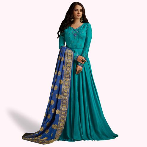 Attractive Teal Blue Colored Partywear Embroidered Rayon Anarkali Suit