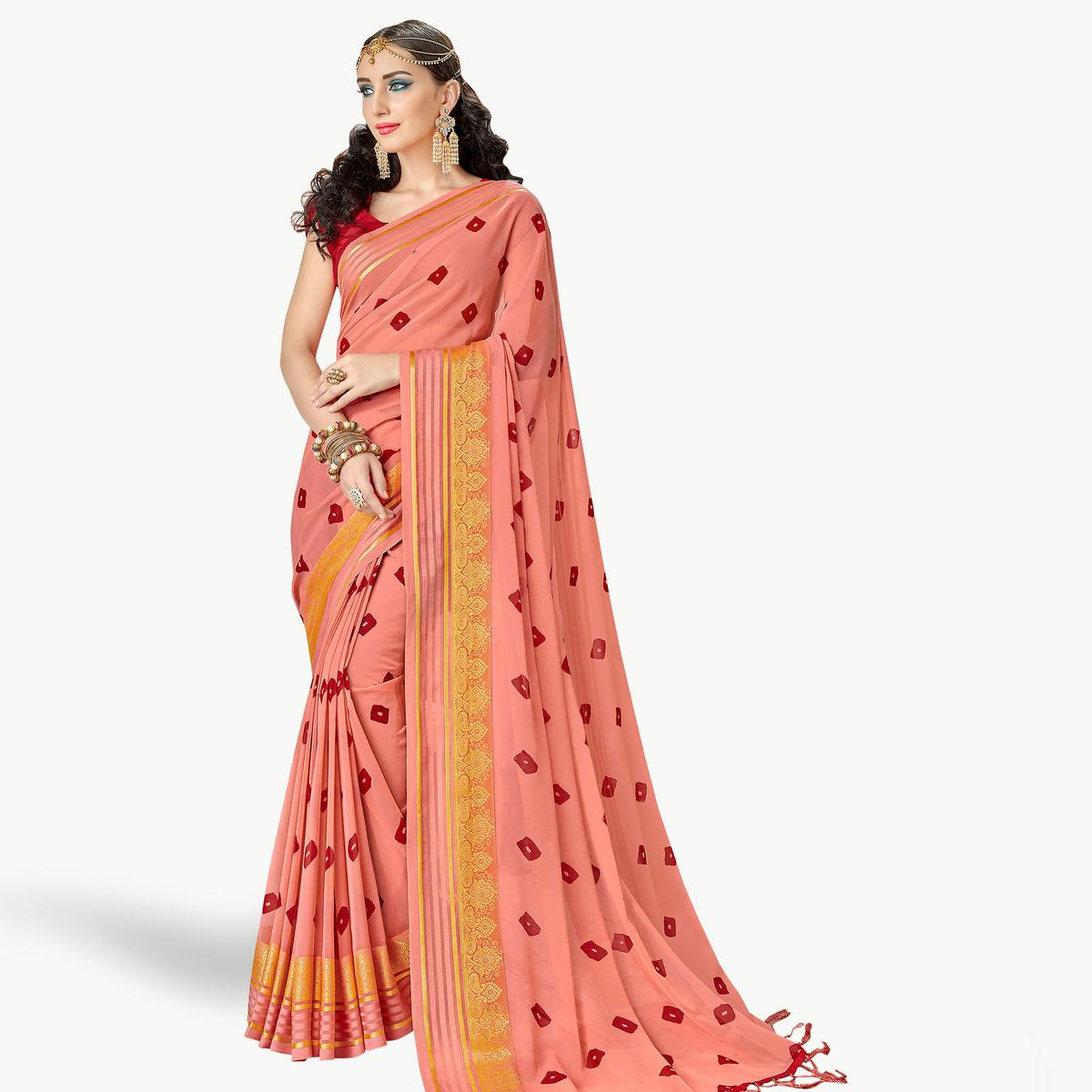 Stunning Peach Colored Party Wear Printed Georgette Saree
