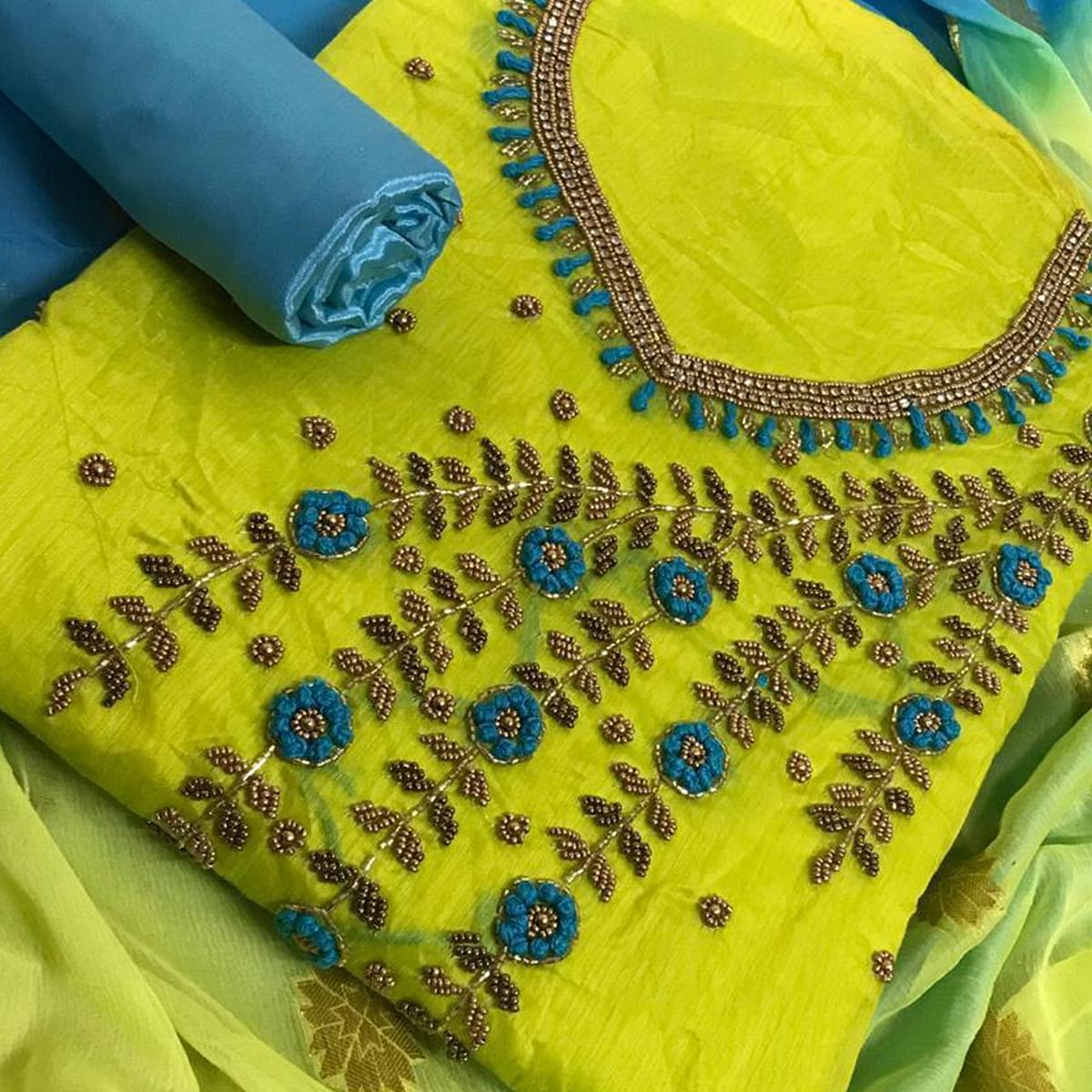 Unique Green Colored Party Wear Embroidered Chanderi Silk Dress Material
