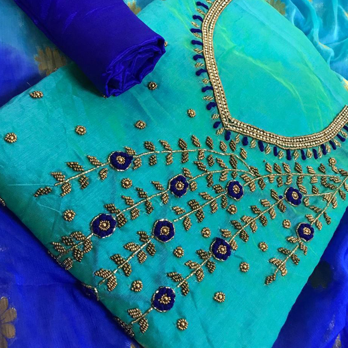 Demanding Sky Blue Colored Party Wear Embroidered Chanderi Silk Dress Material