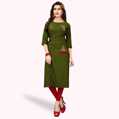 Preferable Dark Olive Green Colored Partywear Embroidered Rayon Kurti