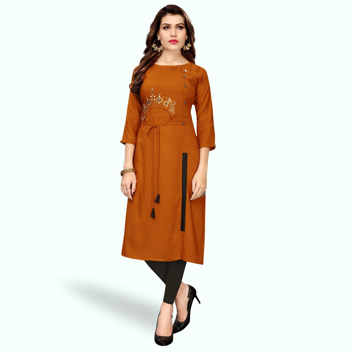 Pretty Burnt Orange Colored Partywear Embroidered Rayon Kurti