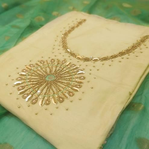 Excellent Beige Colored Partywear Embroidered Cotton Dress Material