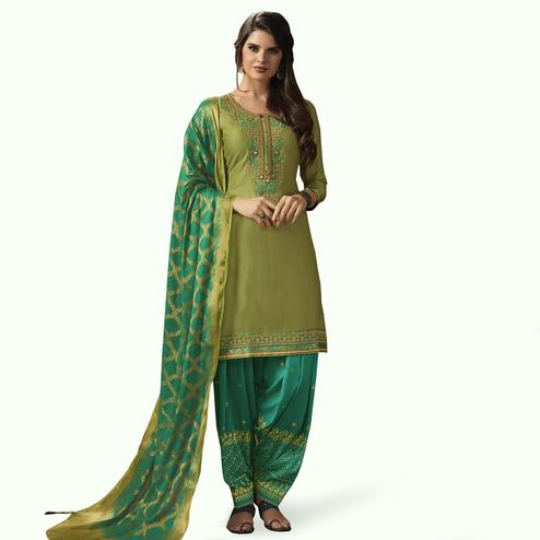 Exceptional Green Colored Partywear Embroidered Silk Patiala Suit