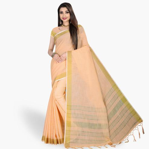 Surpassing Pastel Orange Colored Festive Wear Cotton Linen Saree