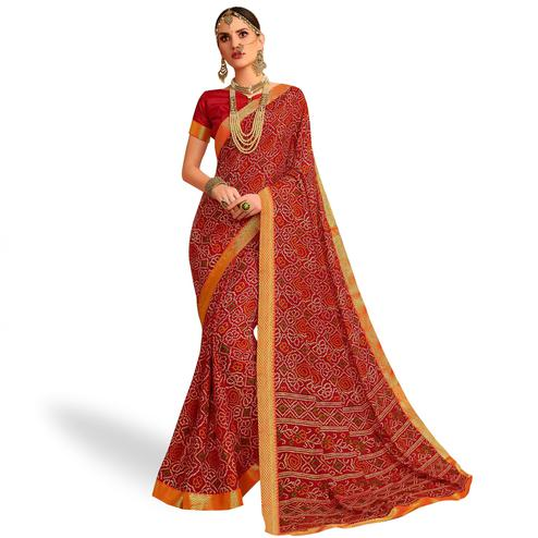 Charming Red Colored Bandhani Printed Heavy Georgette Saree With Jacquard Lace Border