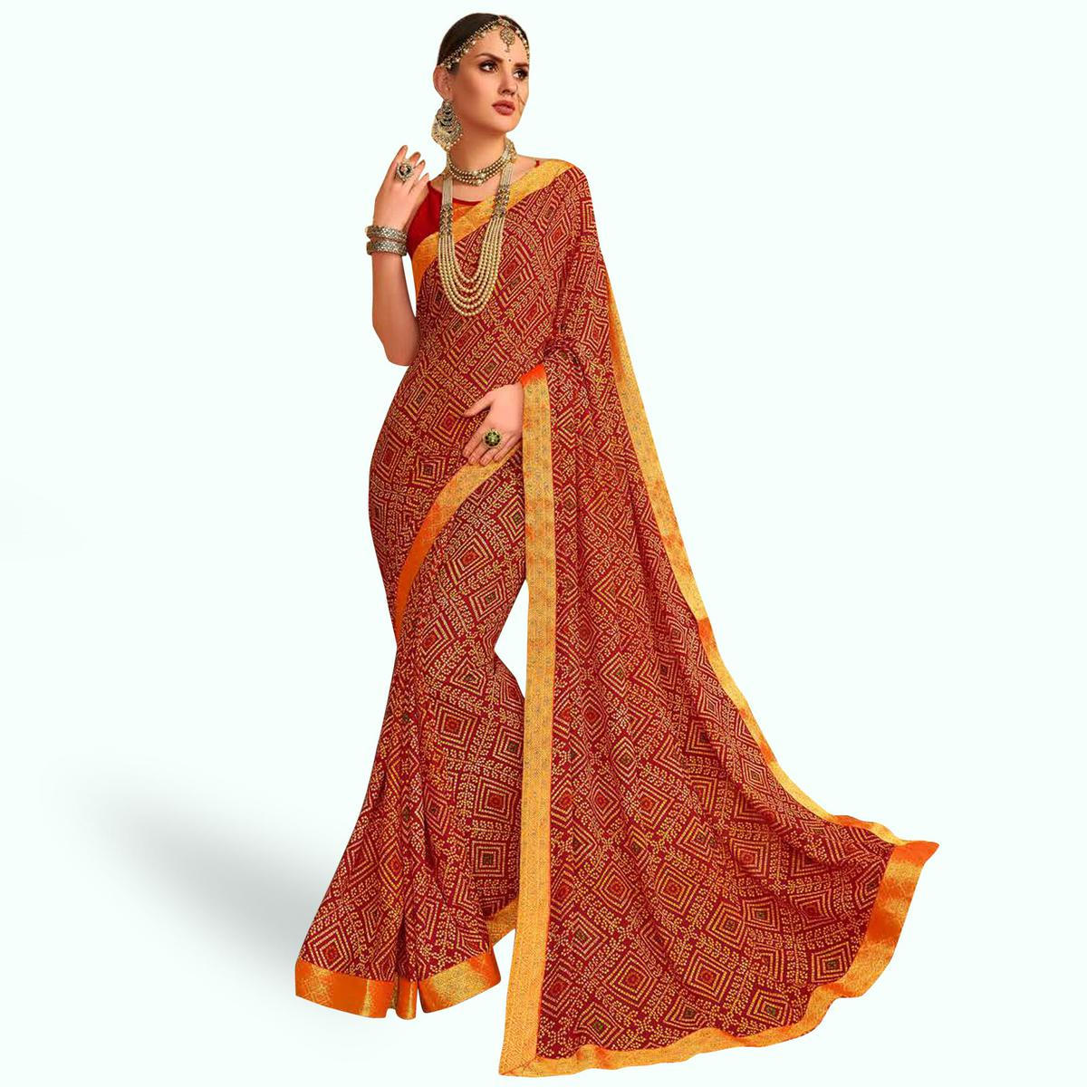 Delightful Red Colored Bandhani Printed Heavy Georgette Saree With Jacquard Lace Border