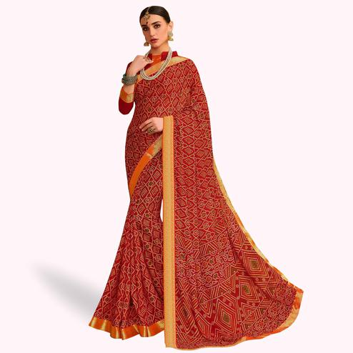 Mesmeric Red Colored Bandhani Printed Heavy Georgette Saree With Jacquard Lace Border
