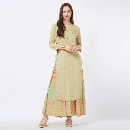 Preferable Pista Green Colored Partywear Embroidered Cotton Long Kurti