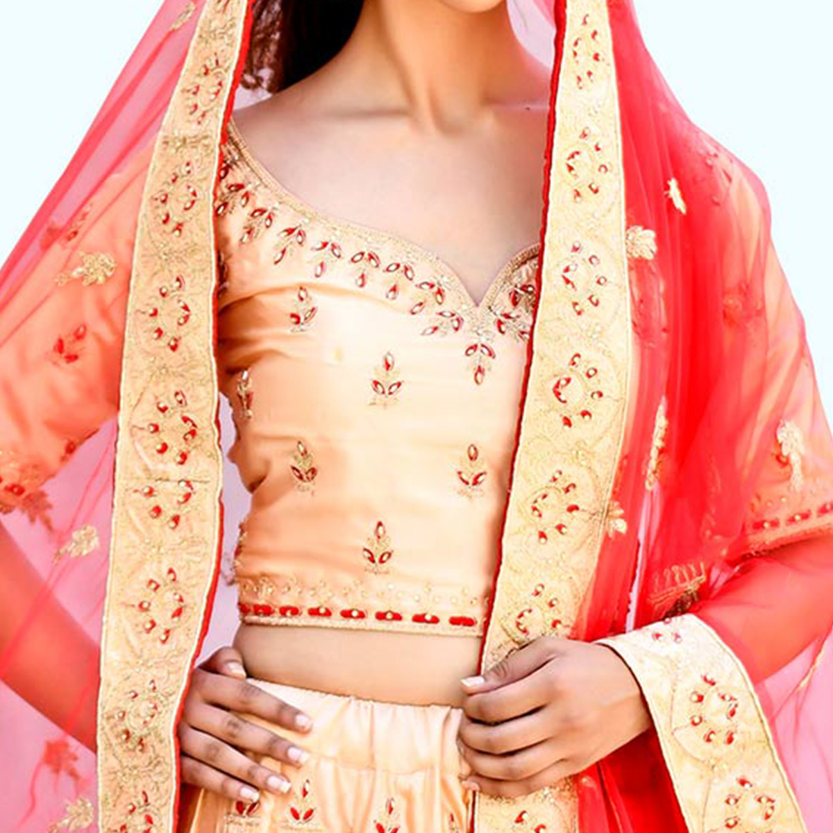 Exotic Peach Colored Partywear Embroidered Satin Lehenga Choli