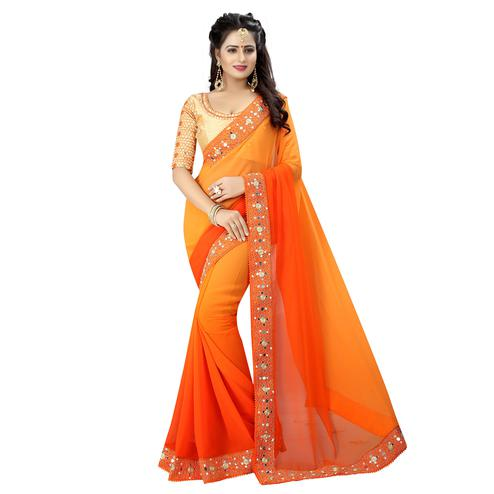 Trendy Orange Colored Party Wear Embroidered Georgette Saree