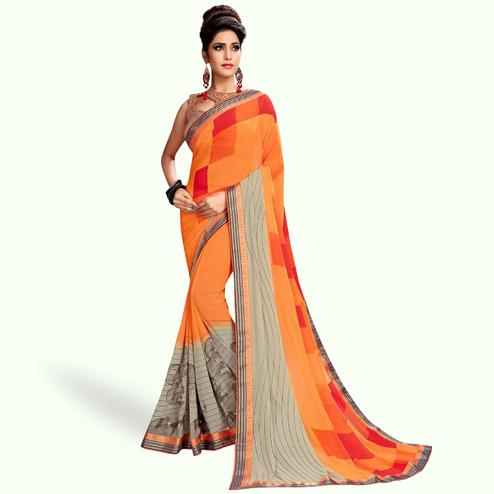 Staring Orange Colored Casual Printed Georgette Saree
