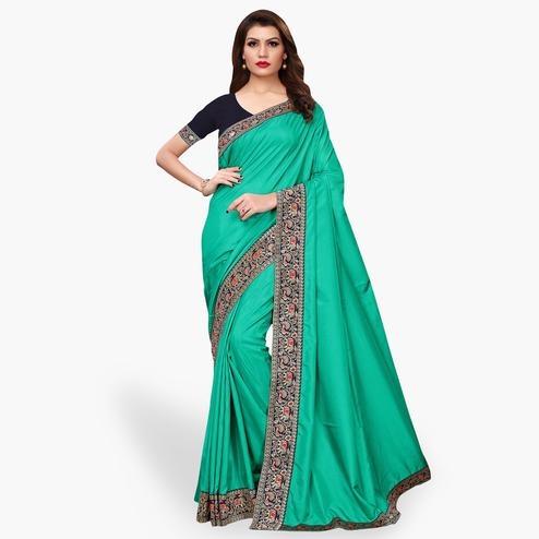 Eye-catching Turquoise Green Colored Party Wear Embroidered Silk Saree