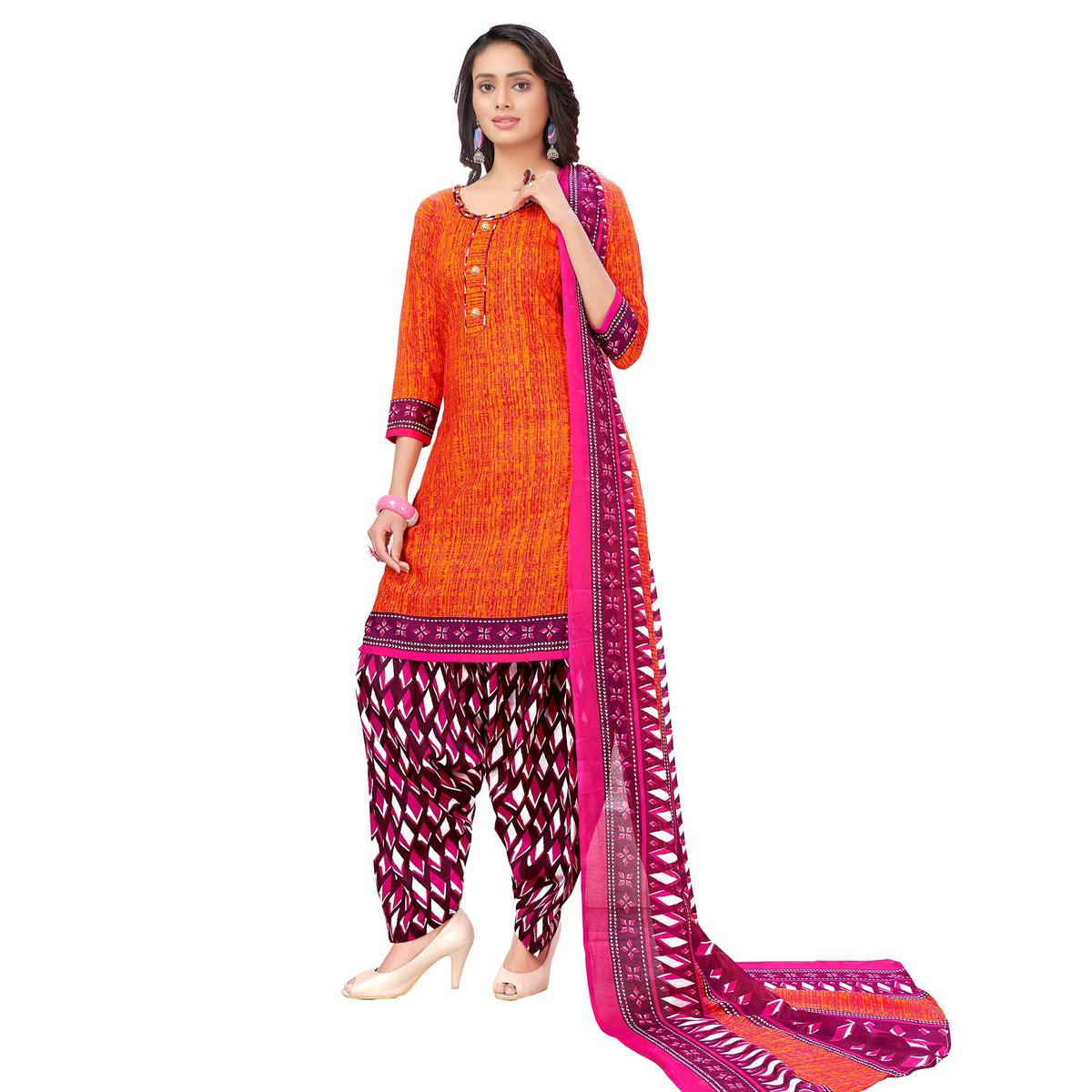 Classy Orange Colored Casual Printed Cotton Dress Material