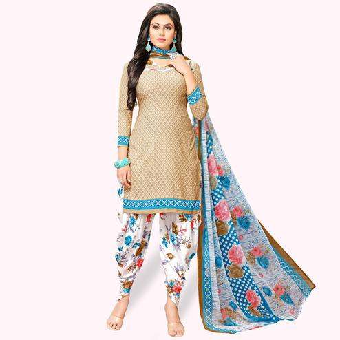 Flamboyant Beige Colored Casual Wear Printed Crepe Patiala Suit