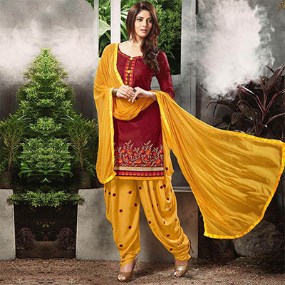 Graceful Maroon Embroidered Cotton Patialia Suit