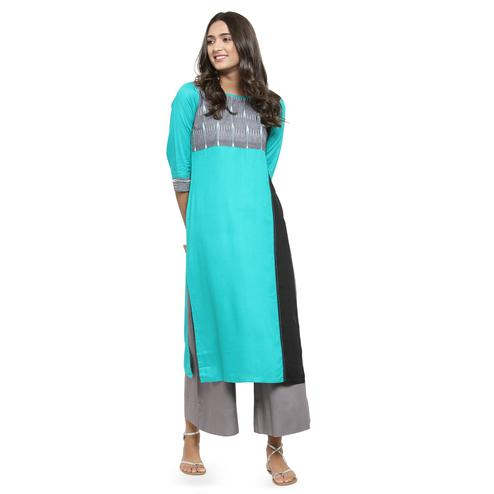 Gorgeous Aqua Blue Colored Casual Wear Printed Rayon Kurti