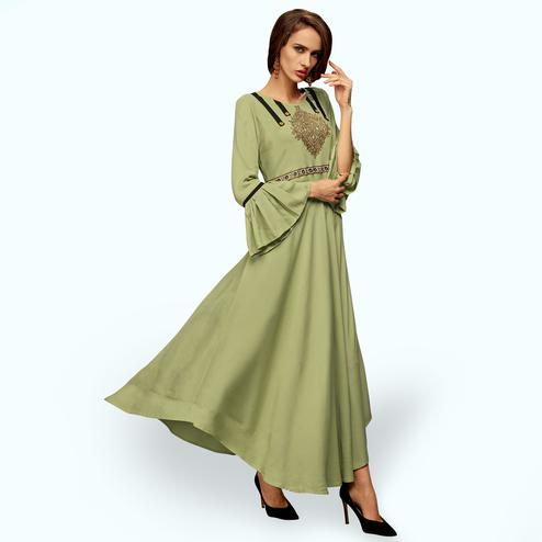 Blooming Pastel Green Colored Partywear Embroidered Rayon Long Kurti