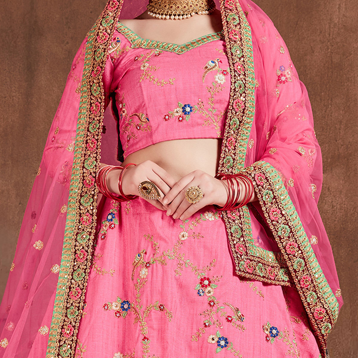 Sensational Pink Colored Partywear Embroidered Art Silk Lehenga Choli