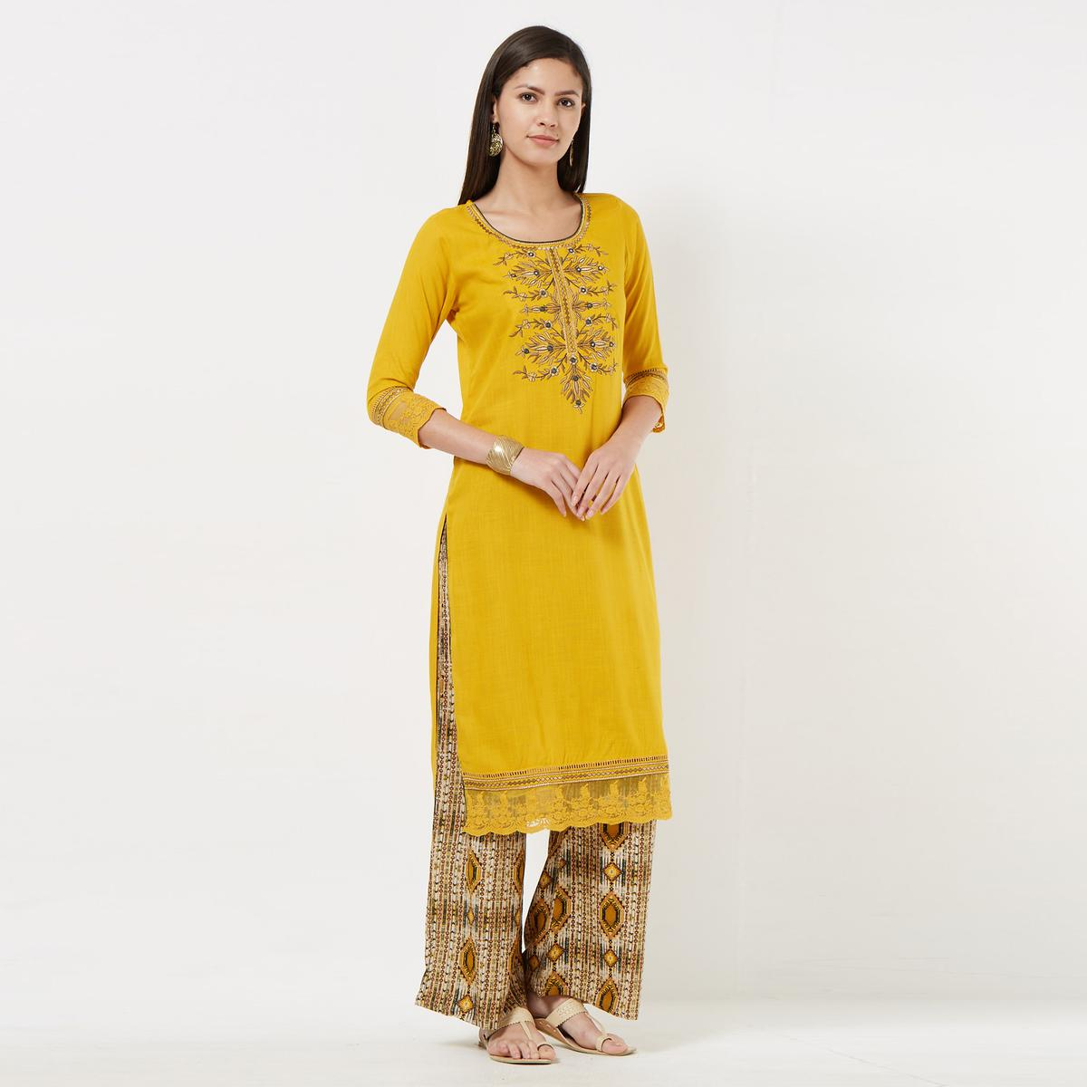 Preferable Yellow Colored Partywear Embroidered Cotton Palazzo Suit
