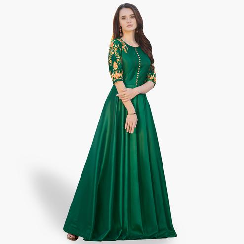 Imposing Green Colored Party Wear Embroidered Tapeta Silk Gown
