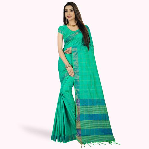 Gorgeous Turquoise Green Colored Festive Wear Woven Silk Saree