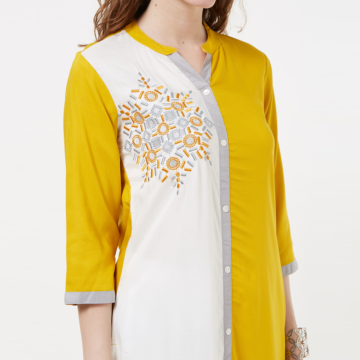 Elegant Yellow-White Colored Casual Wear Embroidered Rayon Kurti