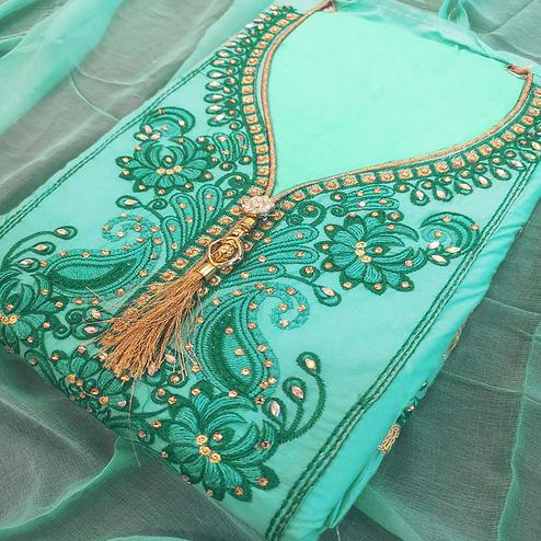 Beautiful Aqua Green Colored Partywear Embroidered Cotton Dress Material
