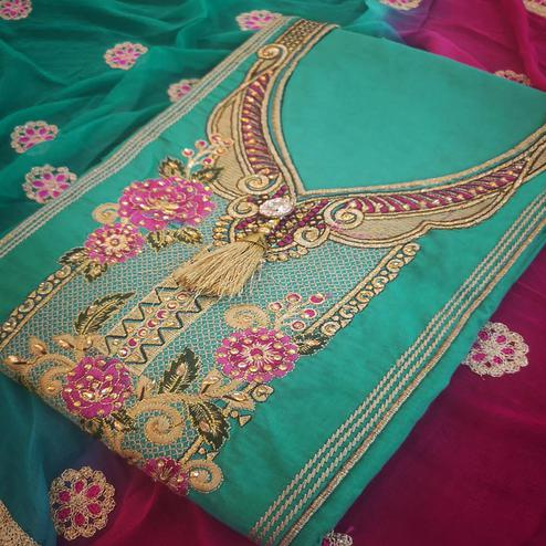 Engrossing Aqua Green Colored Partywear Embroidered Cotton Dress Material