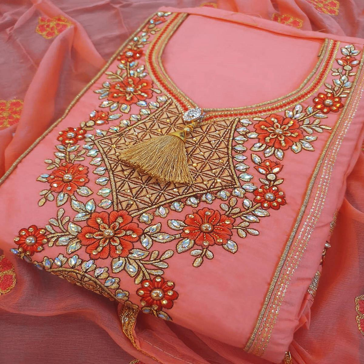 Eye-catching Peach Colored Partywear Embroidered Cotton Dress Material