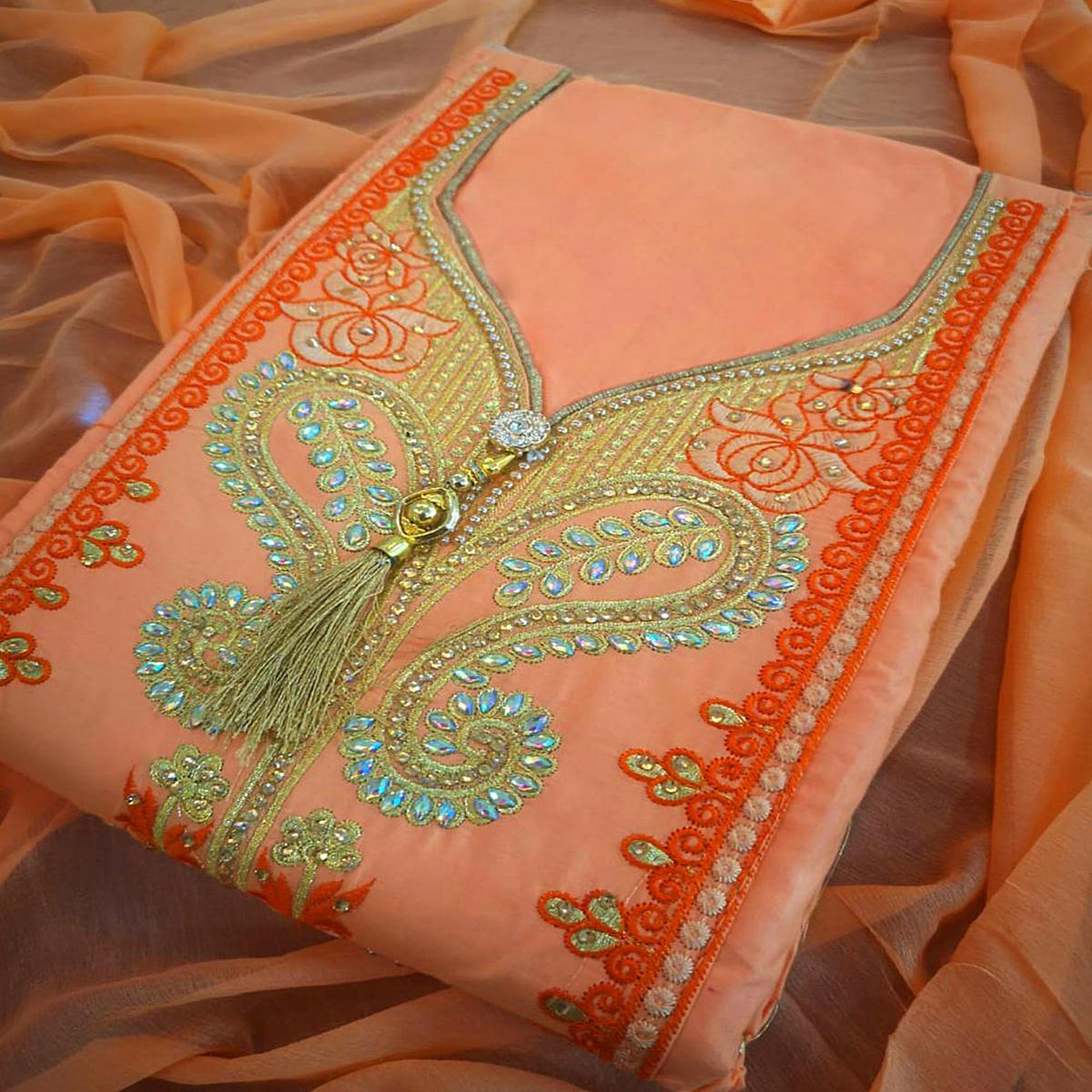 Lovely Orange Colored Partywear Embroidered Cotton Dress Material