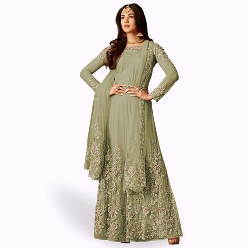 Intricate Pastel Olive Green Colored Party Wear Embroidered Net Anarkali Suit