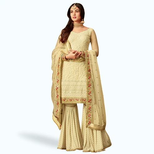 Fantastic Cream Colored Partywear Embroidered Netted Palazzo Suit