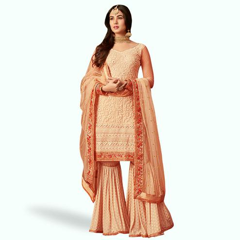 Marvellous Peach Colored Partywear Embroidered Netted Palazzo Suit