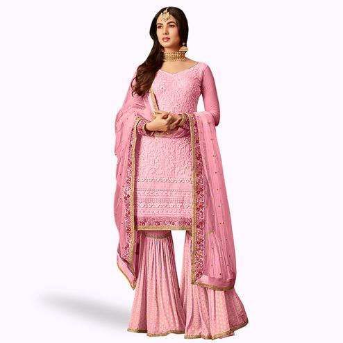 Stunning Pink Colored Partywear Embroidered Netted Palazzo Suit