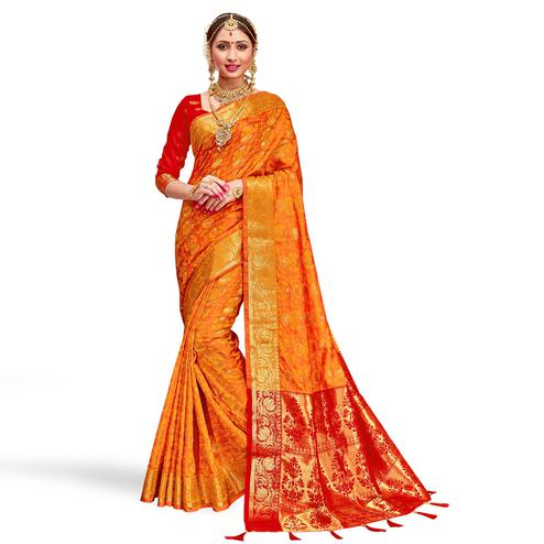 Captivating Orange Colored Festive Wear Woven Silk Saree