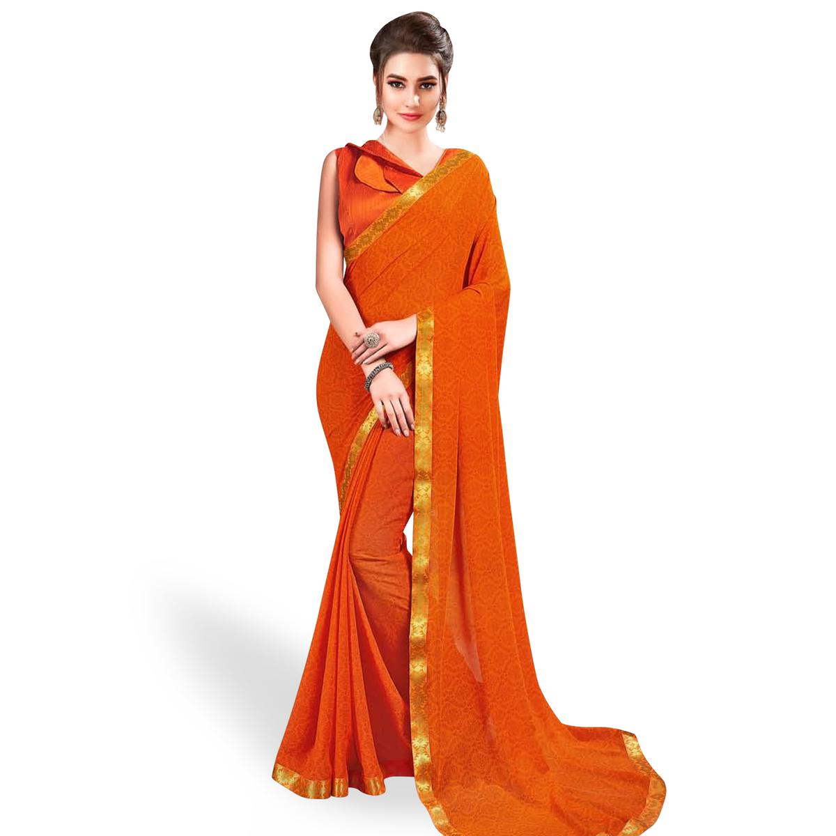Intricate Orange Colored Casual Wear Printed Georgette Saree With Jacquard Lace Border