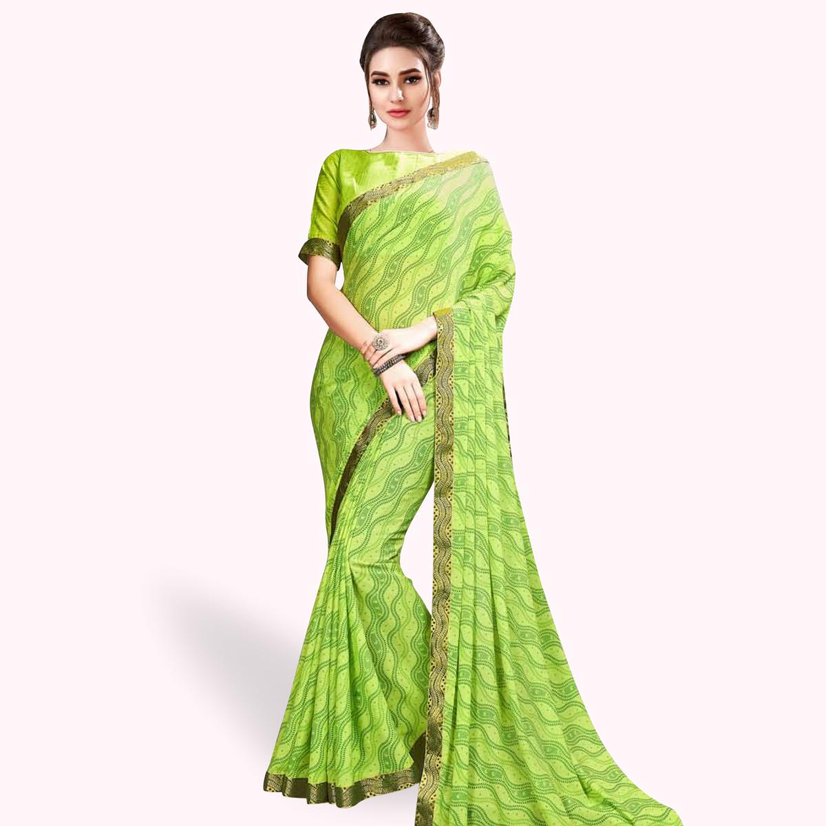 Sophisticated Light Green Colored Casual Wear Printed Georgette Saree With Jacquard Lace Border