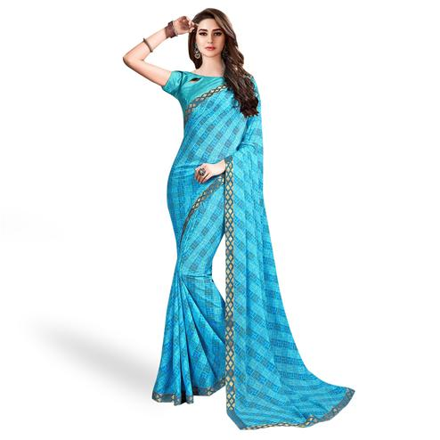 Radiant Sky Blue Colored Casual Wear Printed Georgette Saree With Jacquard Lace Border