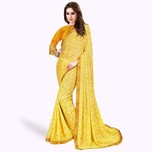 Pleasant Yellow Colored Casual Wear Printed Georgette Saree With Jacquard Lace Border