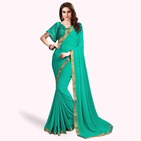 Energetic Turquoise Green Colored Casual Wear Printed Georgette Saree With Jacquard Lace Border