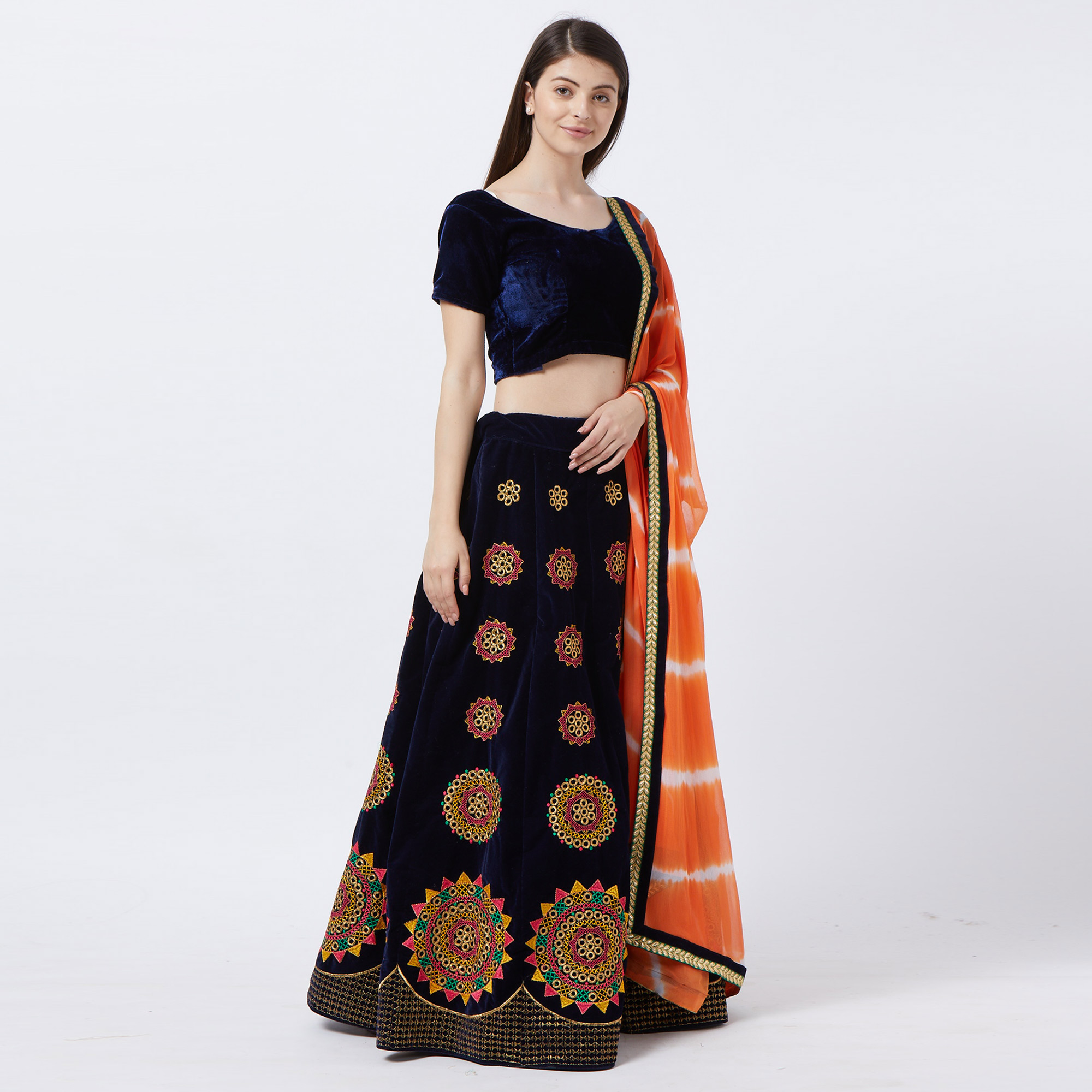 Entrancing Navy Blue Colored Partywear Embroidered Velvet Lehenga Choli