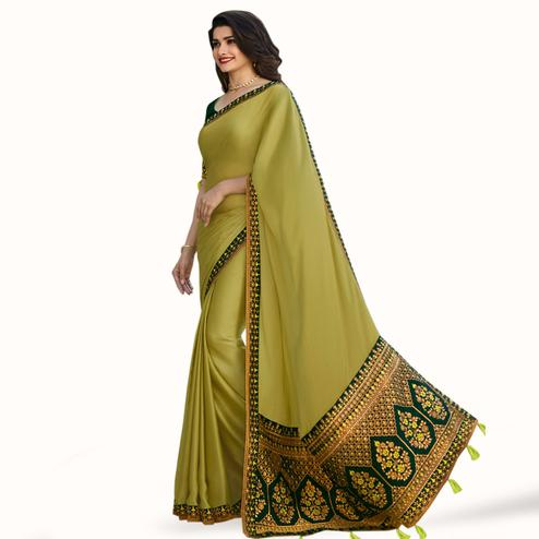 Opulent Olive Green Colored Partywear Embroidered Silk Saree