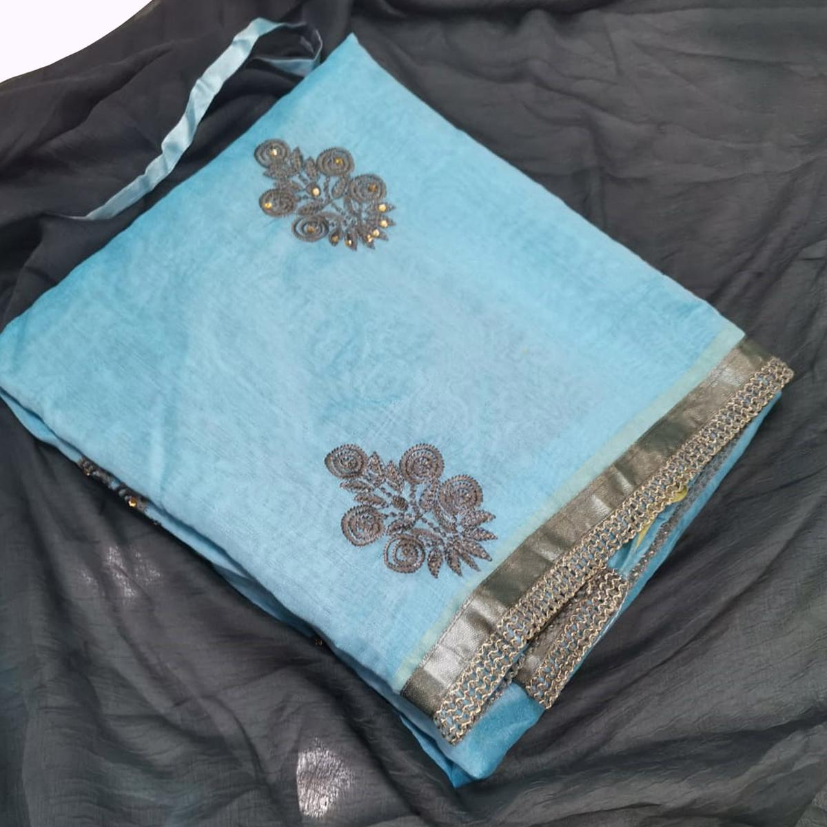 Desirable Sky Blue Colored Partywear Embroidered Chanderi Silk Dress Material