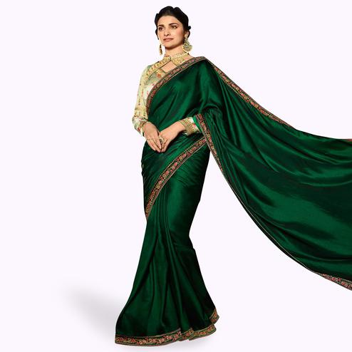 Desirable Dark Green Colored Partywear Embroidered Silk Saree