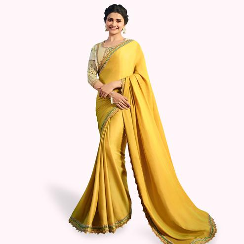 Exotic Yellow Colored Partywear Embroidered Georgette Saree